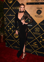 Stella Maxwell got majorly sultry in a black lace-panel cutout gown for the Maxim Hot 100 Party.