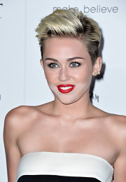 Miley's teased straight locks looked sleek and tamed at the Maxim Hot 100 Party.