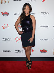 La La Anthony matched her dress with a sexy pair of black strappy sandals.
