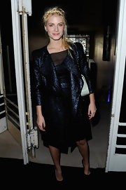 Melanie Laurent attended the Simoens runway show in Paris sporting a stylish navy wool coat.
