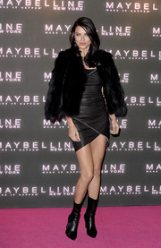 Adriana Lima arrived for the Maybelline Bring on the Night party wearing a black fur jacket over a leather LBD.