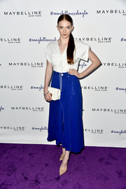 Larsen Thompson was casual-chic in a ruched white blouse by 3.1 Phillip Lim that she accessorized with Leibish & Co jewelry during Maybelline's Los Angeles Influencer event.