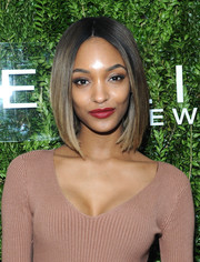 Jourdan Dunn coated her pout in a sexy red hue.