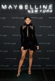 Danielle Herrington looked sassy in a black peekaboo velvet dress by PatBO at the Maybelline Fashion Week party.