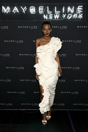 Herieth Paul went the ultra-feminine route in a heavily ruffled one-shoulder dress by Vivienne Westwood at the Maybelline Fashion Week party.