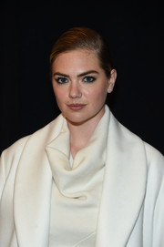 Kate Upton wore her hair in a neat side-parted ponytail at the Jonathan Simkhai fashion show.
