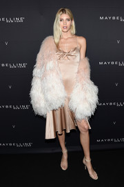 Devon Windsor attended the Maybelline x V Magazine party looking sultry in a gold twist-detail slip dress.