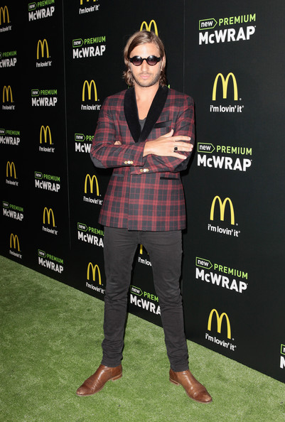 John Martin chose a red and black plaid blazer for his quirky, rocker look.