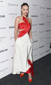 Olivia Wilde was a style standout in a playfully chic red and white flower-cutout dress by Rosie Assoulin at the New York premiere of 'Meadowland.'