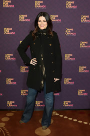 Laura Pausini may have opted for a casual look, but this black wool coat kept her look classically cool.