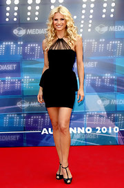 Michelle Hunziker paired her t-strap sandals with a curve-hugging cocktail dress.