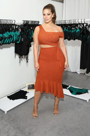 Ashley Graham oozed sex appeal wearing this burnt-orange off-one-shoulder crop-top by Lavish Alice during her meet-and-greet.