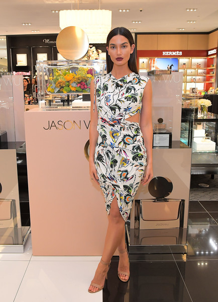 Lily Aldridge paired her dress with nude ankle-strap heels by Gianvito Rossi.
