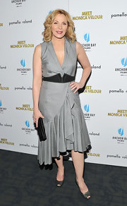 Kim looks sophisticated in a collared gray dress with a dramatic hem ruffle at the 'Meet Monica Velour' premiere.