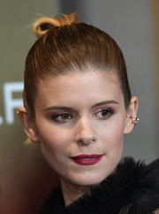Kate Mara chose a deep red hue for her lips.