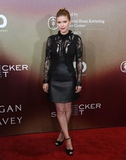 Kate Mara complemented her dress with black ankle-strap peep-toes.