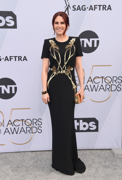 Megan Mullally Metallic Clutch [dress,clothing,carpet,shoulder,red carpet,fashion,fashion model,neck,award,flooring,arrivals,megan mullally,screen actors guild awards,screen actors\u00e2 guild awards,california,los angeles,the shrine auditorium]