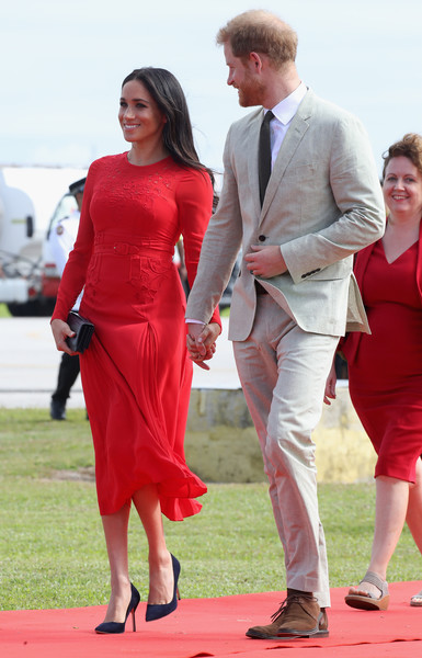 Meghan Markle Midi Dress [red,clothing,red carpet,dress,carpet,suit,fashion,formal wear,cocktail dress,flooring,harry,tonga,duke and duchess of sussex,duchess,sussex,cities,fuaamotu airport,duke of sussex,visit,tour]