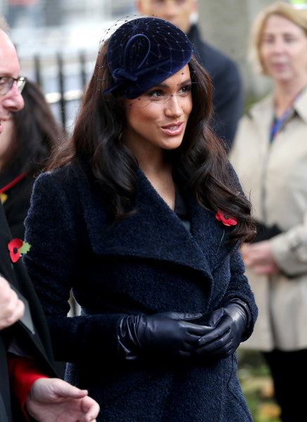 Meghan Markle Leather Gloves [the royal family,lady,street fashion,fashion,beauty,headgear,long hair,outerwear,smile,uniform,brown hair,members,meghan duchess,field of remembrance,westminster abbey,sussex,england,london]