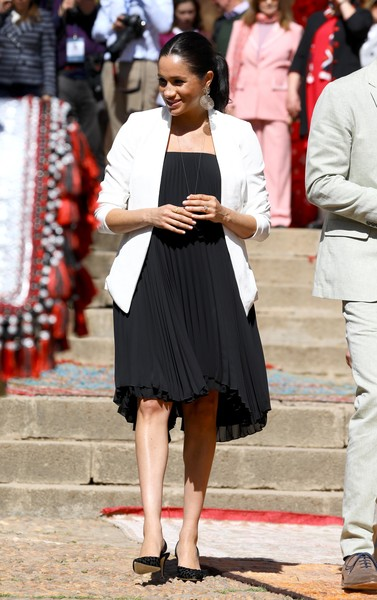 Meghan Markle Blazer [clothing,street fashion,fashion,snapshot,dress,lady,leg,footwear,fashion model,shoe,harry,meghan markle,flowers,sussex,andalusian gardens,duchess,plants,morocco,duke and duchess of sussex visit morocco,visit,meghan duchess of sussex,wedding of prince harry and meghan markle,morocco,duke of sussex,dress,shoe,slingback,royal tours of canada by the canadian royal family,high-heeled shoe]
