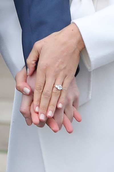 Meghan Markle Engagement Ring [photograph,hand,finger,ring,nail,wedding ring,wedding ceremony supply,gesture,interaction,holding hands,engagement ring,harry,meghan markle,actress,fianc\u00e9e,engagement,engagement,us,britain,announcement]
