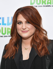 Meghan Trainor sported flowing waves with emo bangs while visiting 'The Elvis Duran Z100 Morning Show.'