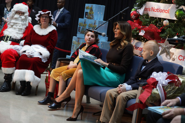 Melania Trump Pumps [story book,santa claus,event,christmas,christmas eve,fictional character,holiday,crowd,tradition,melania trump visits childrens national hospital,melania trump,patients,r,children,lady,tradition,u.s.,visit]