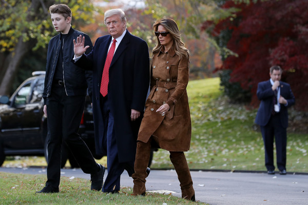 Melania Trump Trenchcoat [the week,news pictures,suit,fashion,standing,event,ceremony,tree,outerwear,dress,formal wear,wedding,donald trump,melania trump,barron trump,u.s.,white house,board,campaign rally,holiday]