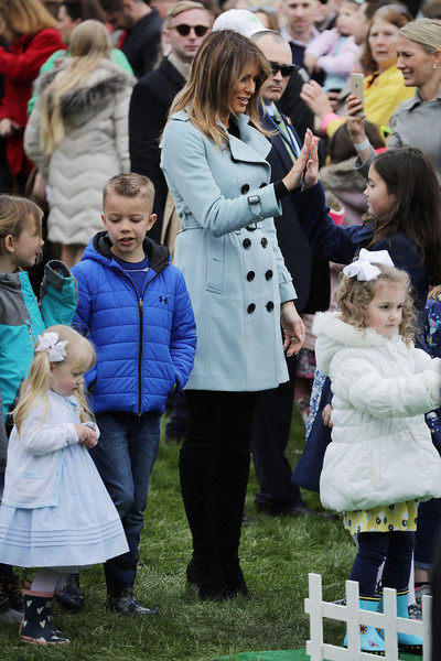 Melania Trump Trenchcoat [people,fur,event,fashion,child,conformation show,fun,recreation,crowd,fur clothing,easter egg roll,lawn bowling activity,white house,lawn,president,mrs.,melania trump,trump host,rutherford b. hayes,participant]