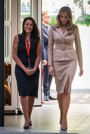 Melania Trump looked sharp in a beige leather skirt suit by Maison Ullens while visiting the Queen Fabiola Children's Hospital in Brussels.