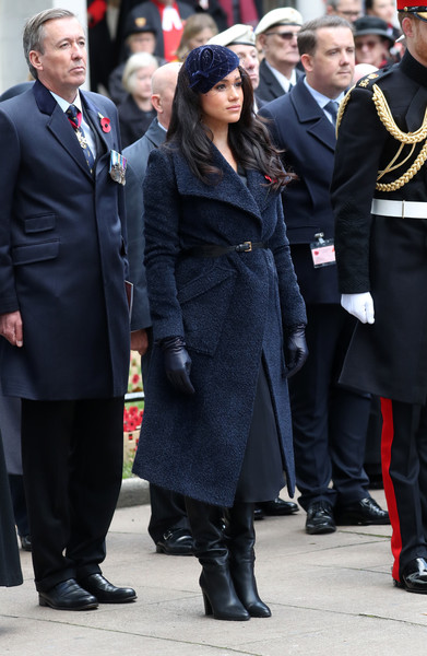 Meghan Markle attended the 91st Field of Remembrance wearing a stylish navy alpaca coat by Sentaler.