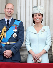 Kate Middleton matched her dress with an ice-blue satin clutch for the RAF centenary event.