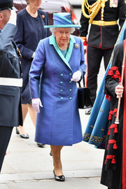 Queen Elizabeth II wore an Angela Kelly silk coat, in blue with mint-green lapels and buttons, to the RAF centenary event.