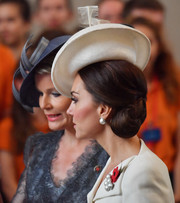Kate Middleton showed off an elegant side chignon at the Passchendaele commemorations in Belgium.