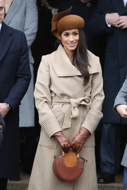 Meghan Markle kept her hands warm in brown leather gloves while attending Christmas Day church service with the royal family.