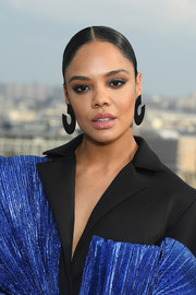 Tessa Thompson sported a slick center-parted bun at the 'Men in Black: International' photocall in Paris.