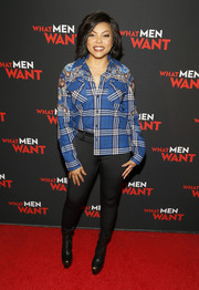 Taraji P. Henson teamed her top with black leggings.