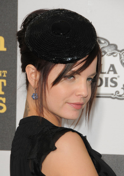 Mena Suvari Decorative Hat [hair,hairstyle,black hair,chin,bangs,forehead,headgear,lip,long hair,fashion accessory,mena suvari,piaget,california,los angeles,nokia theatre l.a. live,25th film independent spirit awards]