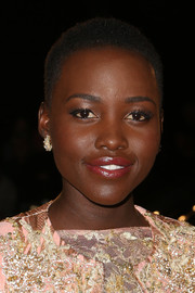 Lupita Nyong'o complemented her beaded outfit with a pair of Cartier diamond studs for a totally classy look during the Palm Springs Film Festival.