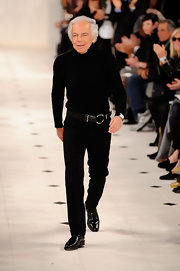 Ralph Lauren closed out his fashion show in black slacks and a turtleneck.