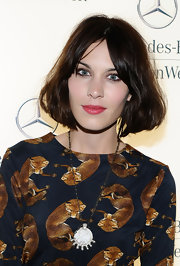 Taking a turn towards the dark side, Alexa Chung showed off a deep brown bob at Mercedes-Benz fashion week.