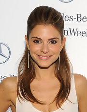 Maria Menounos attended fashion week in NYC wearing her hair in a sleek half-up, half-down hairstyle.