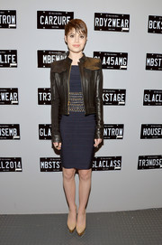 Sami Gayle toughened up her bandage dress with a stylish black leather jacket while visiting the Mercedes-Benz Star Lounge.