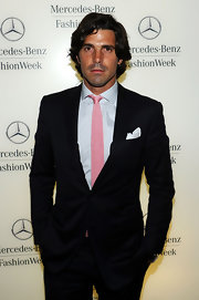 Nacho Figueras' pink knit tie added a nice pop of color to his classic black suit during Mercedes-Benz Fashion Week.