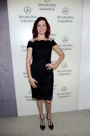 Carrie Preston was ladylike in a deep violet bateau neckline cocktail dress with black lace overlay. She complemented the look with T-strap heels.