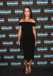 Maggie Q paired her dress with black ankle-strap sandals.
