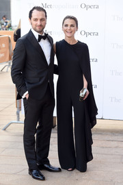 Keri Russell went for easy elegance in an asymmetrical black jumpsuit with cape detailing at the Met Opera opening performance of 'Tristan und Isolde.'