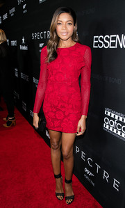 Naomie Harris went for a leggy look in a red macrame lace mini dress by Burberry at the Black Women of Bond Tribute.