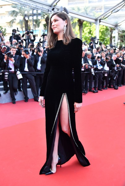 Laetitia Casta showcased her legs in a black Saint Laurent velvet gown with a hip-high, crystal-accented slit at the Cannes Film Festival screening of 'The Meyerowitz Stories.'