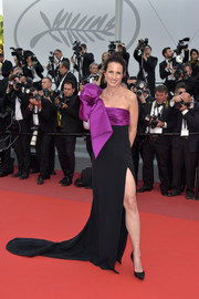 Andie MacDowell worked a black and purple Roberto Cavalli Couture gown, boasting a high side slit and a huge bow detail, at the Cannes Film Festival screening of 'The Meyerowitz Stories.'